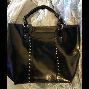 Leather silver studded large black shoulder bag.